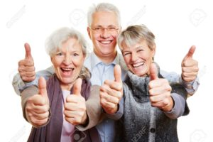 26201482-three-happy-senior-people-holding-their-thumbs-up-Stock-Photo